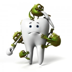 Picture is a white tooth being chewed on by small green sugar bugs.